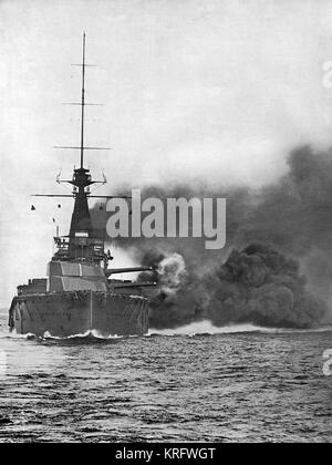 The Orion-class British battleship, H.M.S. 'Monarch', firing her broadside of 13.5 inch guns.  She served in the - Stock Photo