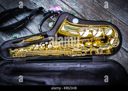 Golden alto saxophone in box - Stock Photo