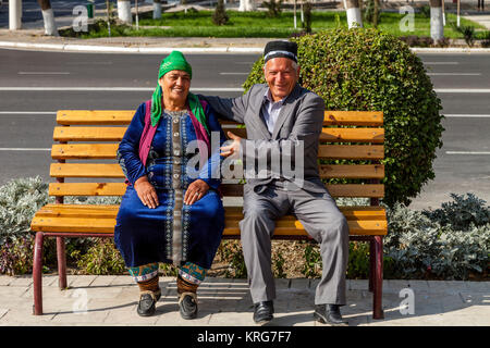 A Senior Uzbek Couple Sitting On A Bench, Bukhara, Uzbekistan - Stock Photo