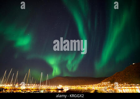 Aurora Borealis, Northern Lights over Tromso, Troms, Norway - Stock Photo