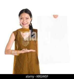 Punjabi female holding blank white paper card. - Stock Photo