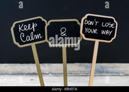 Keep Calm and Do Not Lose Your Way message written with chalk on mini blackboard labels - Stock Photo
