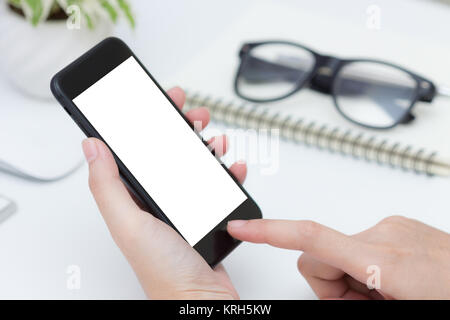 close up hand hold and finger touching on phone white screen - Stock Photo