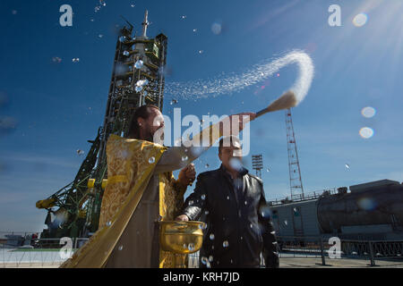 An Orthodox priest blesses members of the media at the Baikonur Cosmodrome launch pad on Wednesday, Sept. 24, 2014, - Stock Photo