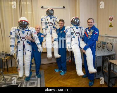 Expedition 43 NASA Astronaut Scott Kelly, left, and Russian Cosmonauts Gennady Padalka, center, and Mikhail Kornienko - Stock Photo