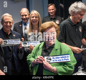 Sen. Barbara Mikulski, D-Md. holds a bumper sticker given to her by members of the New Horizons team at the Johns - Stock Photo
