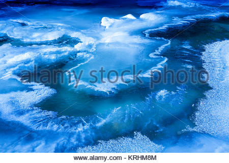 Freeze up ice at beginning of winter Little Rouge Creek in Rouge National Urban Park in Toronto Ontario Canada - Stock Photo