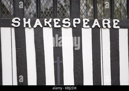 Tudor style Shakespeare sign - letters on a timber frame house - Stock Photo