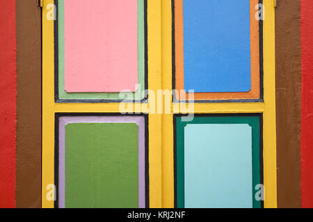Closeup of a window with vibrant colours of a traditional Chinese Peranakan house in Little India, Singapore - Stock Photo
