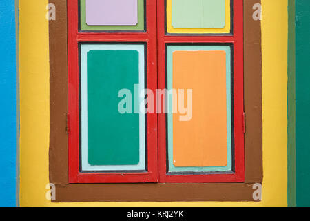 Geometrical background of the colorful window shutters of a Chinese heritage Peranakan house in Little India, Singapore - Stock Photo