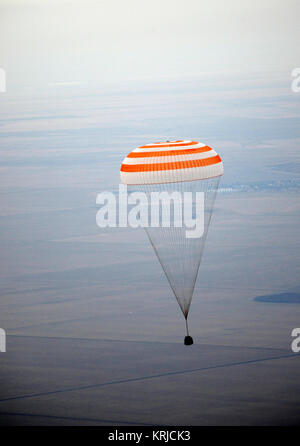 The Soyuz TMA-19 spacecraft is seen as it descends with Expedition 25 Commander Doug Wheelock and Flight Engineers - Stock Photo