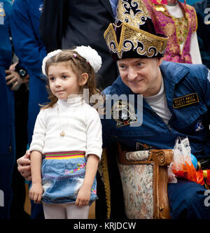 Expedition 26 Commander Scott Kelly poses for a photograph with a local girl while during a ceremony and press conference - Stock Photo