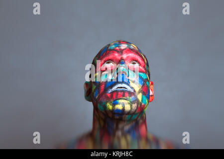 Colorful Superhero face looking up - Stock Photo