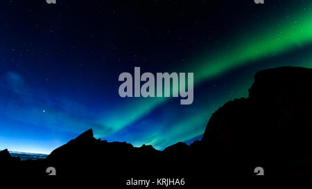 Aurora borealis or northern lights in Norway - Stock Photo