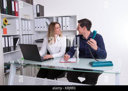 businessman and businesswoman working together in the office - Stock Photo
