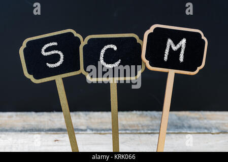 Business acronym SCM as Supply Chain Management - Stock Photo