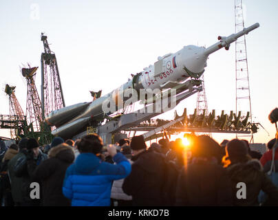 The Soyuz TMA-19M spacecraft is seen as it is raised into a vertical position on the launch pad at the Baikonur - Stock Photo