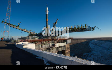 The Soyuz TMA-19M spacecraft is seen after being raised into a vertical position on the launch pad at the Baikonur - Stock Photo