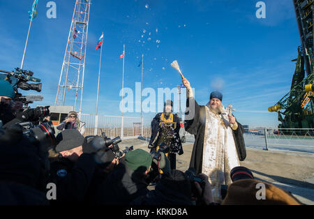 An Orthodox Priest blesses members of the media at the Baikonur Cosmodrome launch pad on Monday, Dec. 14, 2015 in - Stock Photo