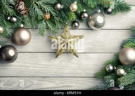 christmas background: wood,pine branches,star and christmas balls - Stock Photo