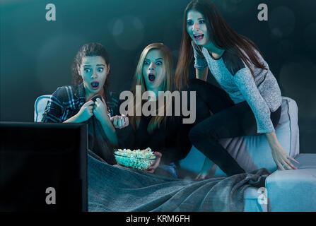 Scared teenage watching movies - Stock Photo