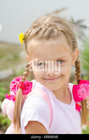 Portrait of a beautiful six year old girl with blond hair - Stock Photo