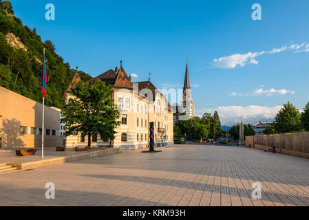 Old building parliament of Liechtenstein and Cathedral of St. Florin on the Sunset in Vaduz, Liechtenstein. - Stock Photo