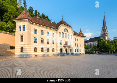 Vaduz, Liechtenstein - May 28, 2016: Old building parliament of Liechtenstein and Cathedral of St. Florin on the - Stock Photo