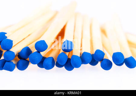 Heap of matches with blue heads isolated on white background - Stock Photo