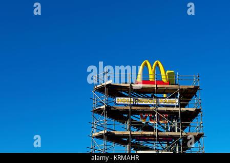 McDonalds logo, and scaffolding, England UK - Stock Photo
