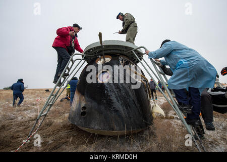 Russian Search and Rescue teams arrive at the Soyuz TMA-18M spacecraft after it landed with Expedition 46 Commander - Stock Photo