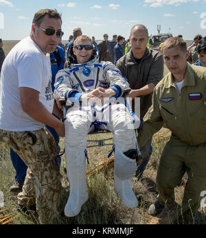 Tim Peake of the European Space Agency is carried to a medical tent after he and Tim Kopra of NASA and Yuri Malenchenko - Stock Photo
