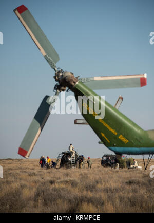 Russian support personnel work around the Soyuz TMA-20M spacecraft after it landed with with Expedition 48 crew - Stock Photo