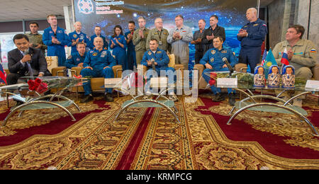 Expedition 48 crew members NASA astronaut Jeff Williams, left, Russian cosmonauts Alexey Ovchinin, center, and Oleg - Stock Photo
