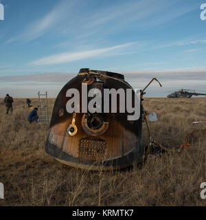 Russian Search and Rescue teams arrive at the Soyuz MS-01 spacecraft shortly after it landed with Expedition 49 - Stock Photo