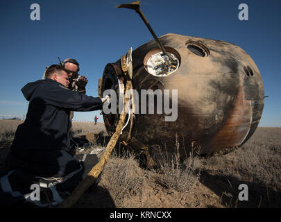 Russian Search and Rescue teams arrive at the Soyuz MS-02 spacecraft shortly after it landed with Expedition 50 - Stock Photo