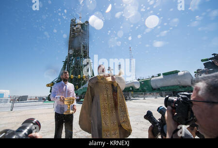 An Orthodox Priest blesses members of the media at the Baikonur Cosmodrome launch pad on Thursday, July 27, 2017. - Stock Photo