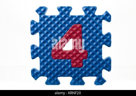 foam puzzle with number four - Stock Photo