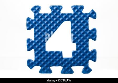 number four rubber puzzle - Stock Photo