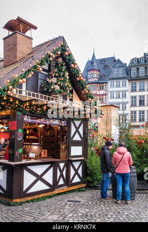 Frankfurt,Germany. Traditional German Christmas Market stalls on Römerberg with historic half-timber terraced houses, - Stock Photo