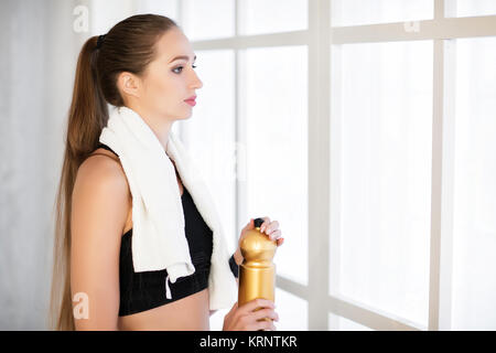 woman with a towel after a workout - Stock Photo