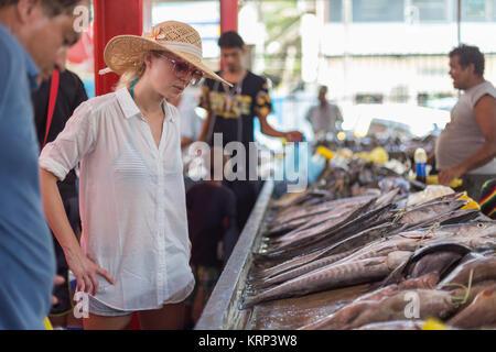 Traveler shopping on traditional Victoria fish market, Seychelles. - Stock Photo