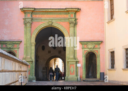 Krakow Castle, tourists pass through the vaulted passageway linking Krakow Cathedral to the Royal Castle courtyard - Stock Photo