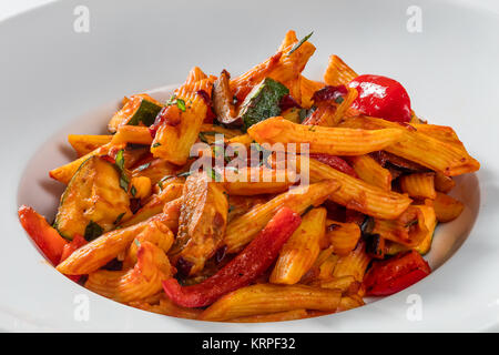 penne with tomatoes and pepper - Stock Photo