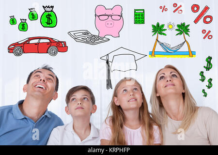Portrait Of  Family With Two Children Looking Up - Stock Photo