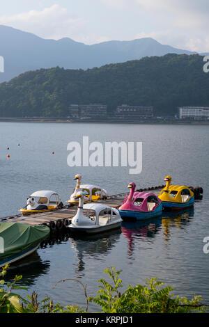 Kawaguchio - Japan, June 14, 2017: Lake Kawaguchio in Fuji Five Lake region with touristic boats in swan shape at - Stock Photo