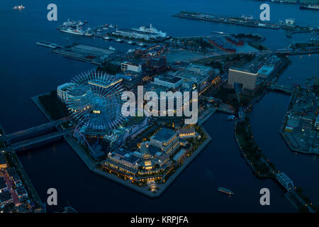 Yokohama - Japan, June 15, 2017; Cosmo World  viewed from the observation deck of Landmark Tower at twilight - Stock Photo