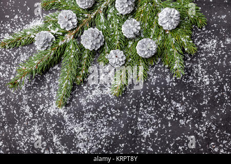 Christmas background with fir and silver cones - Stock Photo