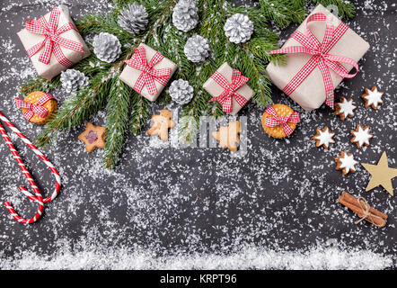 Christmas decoration and food background with snow - Stock Photo