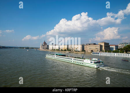 Cruise ship on the Danube, near Parliament buildings, Budapest - Stock Photo